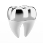 A photo of a tooth with a silver dental crown.